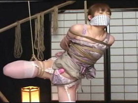 Japanese woman 100% rope bound and spread open